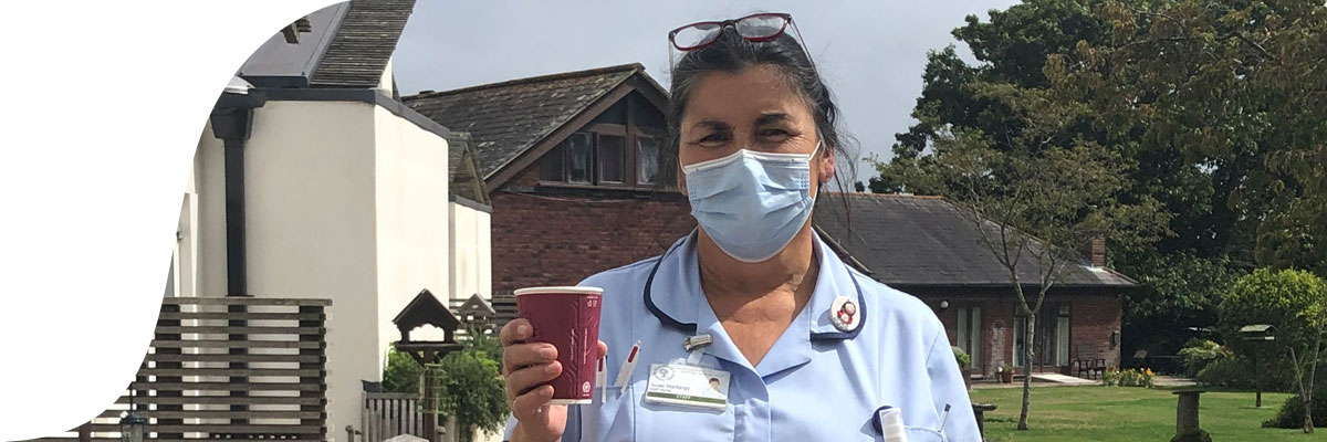 Nurse holding cup of coffee