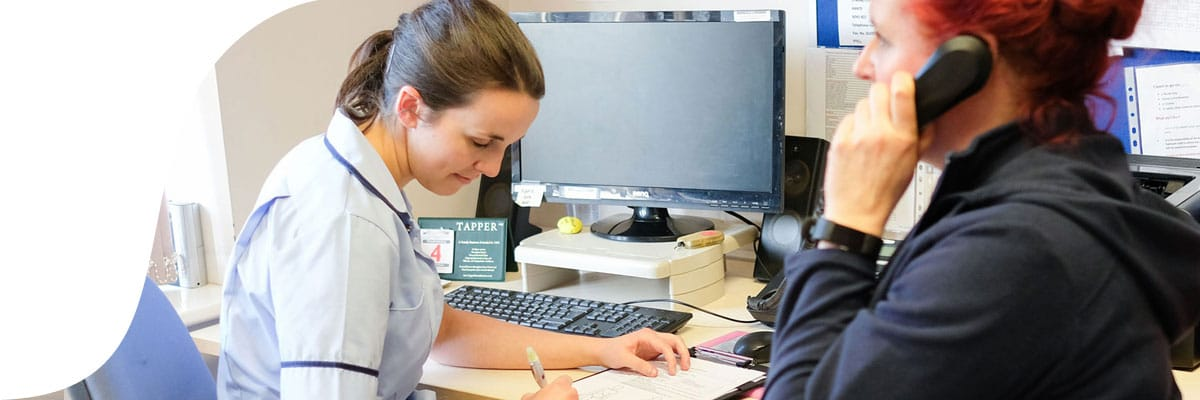 Nurses working in their ward office