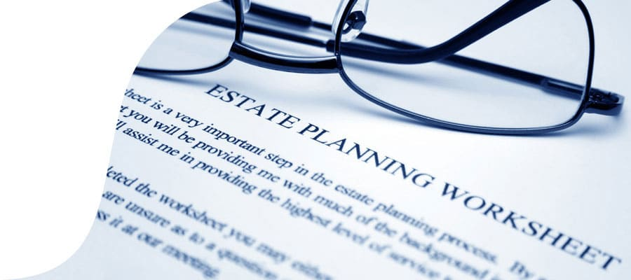 Estate planning worksheet and spectacles