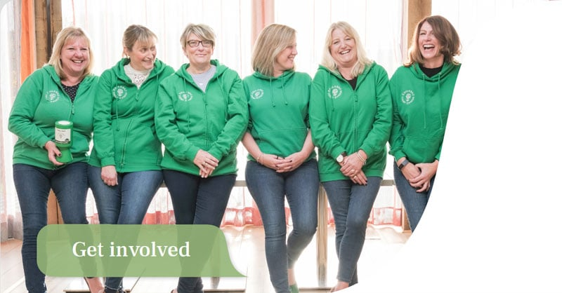Line up of fundraisers wearing green Oakhaven hoodies