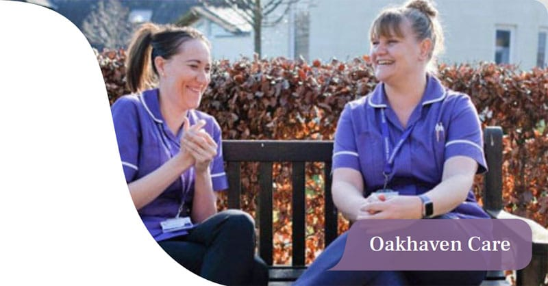 Oakhaven Care nurses sitting on a bench