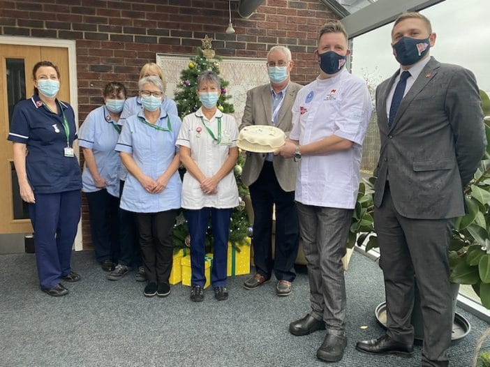 Oakhaven Nurses and Professor Paul Dobson, Chairman receive Thank You cake donated by Royal Lymington Yacht Club and Mosimann's.