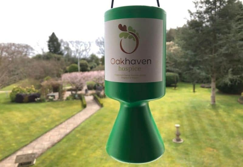 Oakhaven Green Collection Pot with hospice gardens behind