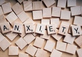 Anxiety spelled in scrabble tiles